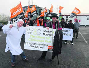GMB union members protesting about working conditions at Marks and Spencer distribution centres, before travelling to Slough for a demonstration. In front are GMB union officials Andy Newman and Chris Watts dressed as Scrooge and Jacob Marley. November 2014